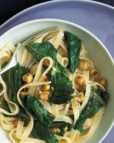 Pasta with Beet Greens, Blue Cheese, and Hazelnuts | Martha Stewart Living - Don't throw out those beet greens! They're great with the robust flavors in this dish. Hazelnuts add crunch to this creamy pasta. Toasted almonds or walnuts work, too.