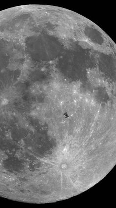 International Space Station silhouetted against the hologram of the moon