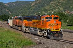 https://flic.kr/p/w1mLqA | BNSF 9011 Palmer Lake 11 Jul 15 | BNSF 9011 and a sister ACe (along with a lone loaded coal hopper) are are the spur track in Palmer Lake, CO, waiting to be used as manned helpers.