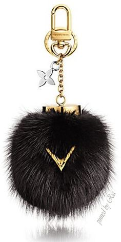 "Louis Vuitton Luxurious Black Mink Fur Bag Chain Adorned with a Golden ""V"" for…"