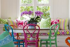 i want a table with all different colored chairs!