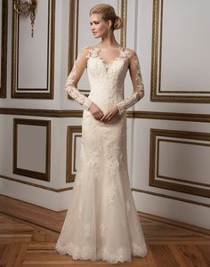 Justin Alexander wedding dresses style 8812 Floating lace details on this Sabrina neckline and sleeves, beaded Alencon lace on soft tulle and illusion low back will leave every bride feeling sophisticated and glamorous in this straight silhouette.