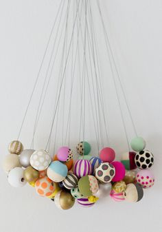 I know these are necklaces, but the way they are displayed looks like a mobile - could be really cool!