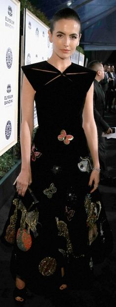 Who made Camilla Belle's black print dress and platform shoes?