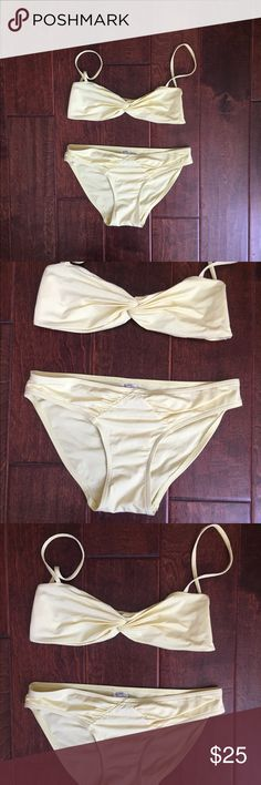 Calvin Klein Yellow Bikini An effortlessly cool swimwear choice by Calvin Klein bandeau twist bikini top. Cut with a ruched twist-effect from the most flattering finish, in a bright yellow hue. Pre-Owned. In good condition. Calvin Klein Swim Bikinis
