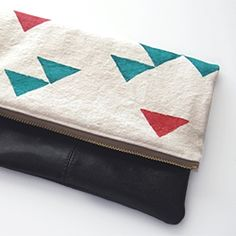 """A stylish and simple-to-sew accessory. Use an old purse to jazz up one of my favorite """"skirt as top"""" tutorials, the foldover clutch!"""