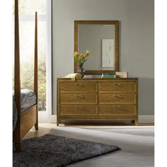 This mirror adds a wonderful design highlight to your home. Featuring a rectangular design, the mirror showcases a frame crafted from various woods and veneers and completed with a light brown finish. Perfect for the top of a dresser or larger chest, this mirror presents timeless style for your living or bedroom space.
