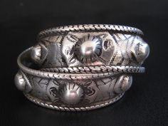 """A pair of gorgeous Palestinian Haydari bracelets in silver, posted by Preethi on Ethnic Jewels.  Here is what Nada says about the signature on these, """"M is signed """"Hanna"""" which means that they are the work of Yacoub Zakariya who always signed his work """"Hanna"""", the name of his father. He started his work in Nablus and worked as a silversmith in Jerusalem and then Bethlehem until the 1967 war when he settled in Jordan."""""""
