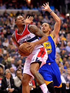 Washington guard Bradley Beal left gather a round against Golden State guard Stephen Curry as the Washington Wizards play the Golden State Warriors...