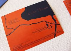 wedding invitation in navy and orange