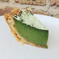 Matcha-buttermilk chess pie. An airy, puff pastry crust -- paired with a beautiful, matcha-buttermilk custard filling (made with crème fraîche rather than sour cream, in order to allow the matcha's delicate flavor to truly shine.) Topped with Chinese green tea powder.