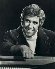 Burt  Bacharach  May 12, 1928 is an American pianist, composer and music producer of popular hit songs and compositions from the mid-1950s through the 1980s, with lyrics written by Hal David.