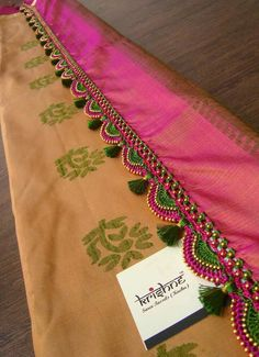 This handcrafted tassel work is being done on premium quality threads and beads that your silk saree rightfully deserves.Now scroll down to take a good look at how these tassel work can magnify the beauty of any silk saree. Saree Tassels Designs, Saree Kuchu Designs, Wedding Saree Blouse Designs, Mehndi Designs, Embroidery Patterns, Hand Embroidery, Maggam Work Designs, Saree Blouse Patterns, Elegant Saree