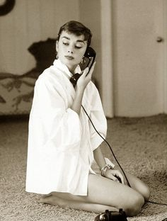 audreyhepburnjustchillin: Audrey Hepburn photographed by Mark Shaw, 1953. Audrey Hepburn… Just chillin' on the line. How awesome am I? Totally. Yeah, that's what I thought. What?!