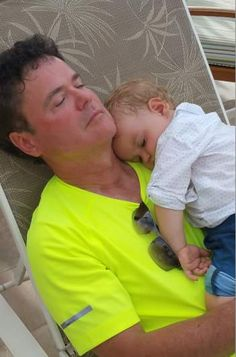 Donny with sleeping grandson