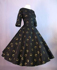 1950s full skirted dress with gold metallic dots.