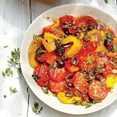 Refreshing Roasted Peppers and Tomatoes with Herbs and Capers are served chilled!