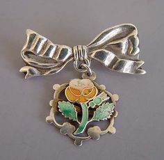 VICTORIAN silver enamel bow brooch, orange flower from Morning Glory Jewelry. Buy now for $98.00