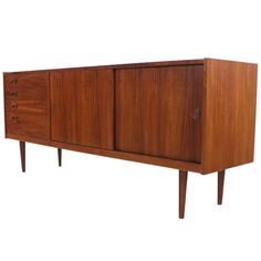 Danish Modern Teak Credenza Designed by Kai Kristiansen | From a unique collection of antique and modern credenzas at http://www.1stdibs.com/furniture/storage-case-pieces/credenzas/