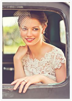 off the shoulder lace gown and bird cage veil