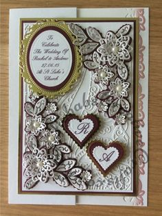Wedding card made using a variety of dies including Tattered Lace double delights adore & Kaleidoscope flower corner dies, Spellbinders floral and plain nesting ovals & scalloped and plain nesting hearts. Sentiment printed. monograms printed.
