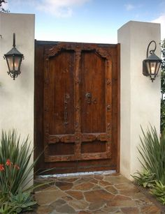 Love this wooden door and the lanterns.