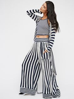 Fake It Till You Make It Set | Make a statement in this three-piece super soft and comfy set featuring a contrast striped pattern.  Exaggerated wide leg pants with an elastic waistband and hip pockets. Cropped tank is in a halter style with an open back and adjustable ties. Long sleeve wrap style jacket has an adjustable waist tie.