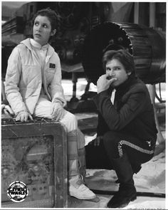 Leia and Han Solo  - Either between takes or between promo shots, probably the later. Love the expressions, though.