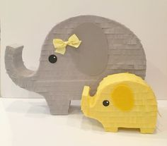 Mommy and baby elephant. Elephant Baby shower decor and/or centerpiece.. So sweet! Surprise Piñata is a gift delivery service of personal sized pinatas!   Fill it with pretty much anything and ship across the United States! Surprisepinata.com