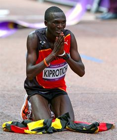 Stephen Kiprotich of Uganda celebrates crossing the finish line to win gold in the Men's Marathon on Day 16. Add Around The Rings on www.Twitter.com/AroundTheRings & www.Facebook.com/AroundTheRings for the latest info on the #Olympics.