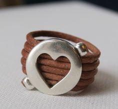 Leather Ring. Light Brown Leather and Metal Heart Piece Ring.. $13.00, via Etsy.