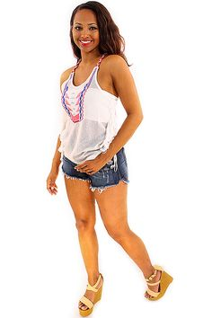 Festival Chick Tank - Fun and funky in a white tank. Neon pink and blue tribal arrow embroidery add flair to a fishnet tank with shredded tassels adorning the side hems. Neon threaded racer back straps complete the look creating a boho cool look. A lightweight and colorful tank to pair with cutoff denim shorts. A must have for that indie music festival this spring!  - available online at http://www.envyboutique.us/shop/festival-chick-tank/ #Envy #Boutique #chic #fashion #fash