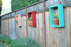 9 DIY Ideas to Improve Your Backyard - something like this for your deck's wood screen??? (of course you would actually have to water the flowers, haha)