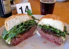 Los Angeles: Father's Office   Signature Burger: The Office Burger (dry-aged beef patty topped with Gruyère cheese, Maytag blue cheese, arugula and applewood-bacon compote).     Sang Yoon's noodle bar Lukshon might be getting a ton of buzz, but the provocative chef first made his name with his dry-aged beef burgers. Among the finest in the country, they justify the strict no-ketchup policy. The 36 craft beers on tap change seasonally. www.fathersoffice.com/ (good bar/beer too)