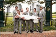 bride with groomsmen photos