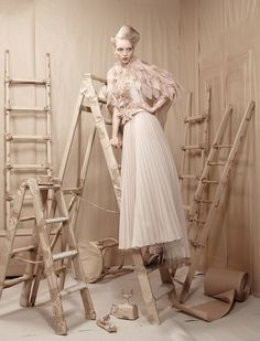 Packing paper props and scenery, almost steal the show away from the elegant Anastazja Niemen in this fashion editorial for L'Officiel Ukraine, created by Lucia Giacani.