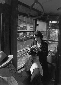 Femme lisant dans le tramway à Milan, Italy, 1997, photograph by Ferdinando Scianna.