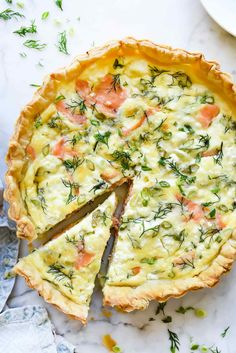This quick and simple quiche comes together fast thanks to a puff pastry crust filled with custard-ey eggs, smoked salmon, and crème fraîche or goat cheese. This quiche is simple and far from complicated, and as suggested, it's easy to… Continue Reading → Smoked Salmon Quiche, Smoked Salmon Recipes, Smoked Salmon Breakfast, Fish Recipes, Seafood Recipes, Recipies, Leek Quiche, Goat Cheese Quiche, Best Brunch Recipes
