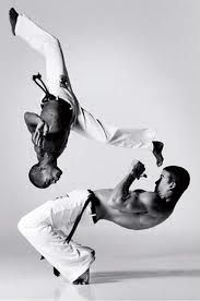 Capoeira, a Brazilian martial art that combines elements of dance and music. It was developed by African boys brought by the Portuguese to Brazil as slaves, probably beginning in the 16th century (wikipedia)