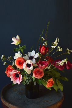 """30 Perfect Picks From Home-Design Pros #refinery29 Assorted Flowers In Recycled Bottle Vase, $90, available at Tin Can Studios. """"This floral studio creates the most eye-catching arrangements you've ever seen. Plus, they come inside recycled and old-timey brass urns, glass bottles, and wood crates."""""""