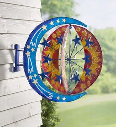 Sun, Moon and Stars Wall Wind Spinner | Decorative Garden Accents | The half-moon base with painted stars holds the triad of laser-cut sun pieces, which hold the stars spinner in the middle. Both interior spinners twirl opposite ways for a stunning effect.