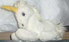 I was obsessed with unicorn everything!  I had this plush unicorn.