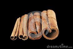 Cinnamon sticks isolated on black background.