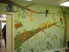 Jungle themed mural for an infant school library. by Charlotte Designs