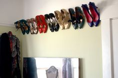 Store pretty shoes on crown molding! Inspired by this image on Pinterest: pinterest.com/pin/20336635786950292. #heels #DIY #storage #organization #wall