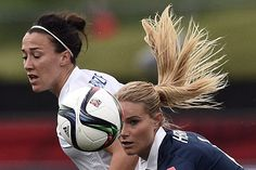 France's midfielder Amandine Henry (R) eyes the ball during a Group F match at the 2015 FIFA Women's World Cup between France and England at Moncton Stadium in Moncton, New Brunswick on June 9, 2015. AFP PHOTO / FRANCK FIFE