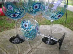 Hand painted blue peackcock feathered red wine balloon goblets.  So soft and romantic, as well as hand painted. $20.00, via Etsy.