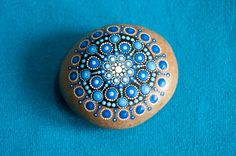 Hand painted Mandala Stone using acrylic paint and protected with Matt varnish.  This is one of a kind stone and is about 6 cm long.  Please