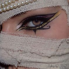 Appropriating the Egyptian Culture by using the Eye of Horus meaning to symbolize Royalty as makeup for Costume. - Appropriating the Egyptian Culture by using the Eye of Horus meaning to symbolize Royalty as makeup for Costume. Makeup Inspo, Makeup Art, Makeup Inspiration, Beauty Makeup, Makeup Ideas, Gold Makeup, Skull Makeup, Mummy Makeup, Costume Makeup