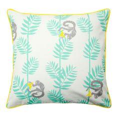 Singes vifs et palmes exotiques se dessinent sur cette enveloppe de coussin Hawai à passepoil jaune et aux tons colorés et rafraichissants qui raviront les férus de naturel.
